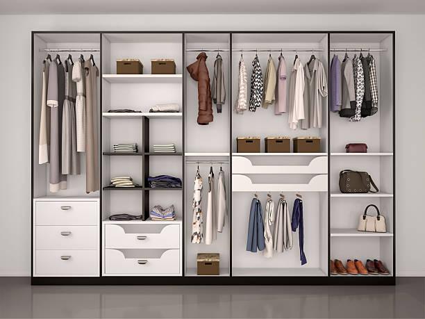 wide closet with a large window, - kleiderschrank ohne türen stock-fotos und bilder