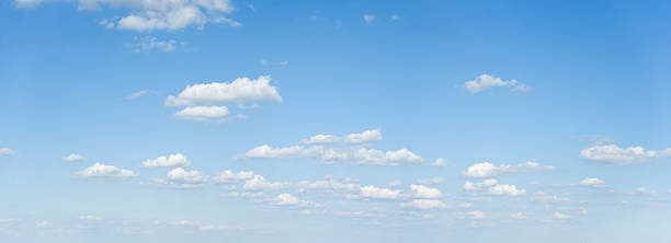 wide cloudscape on a clear blue sky - natural phenomenon stock photos and pictures
