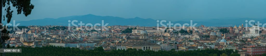 Wide dusk panorama of Rome with main architectural international landmarks from Janiculum hill viewpoint with famous Pantheon and Altare della Patria stock photo