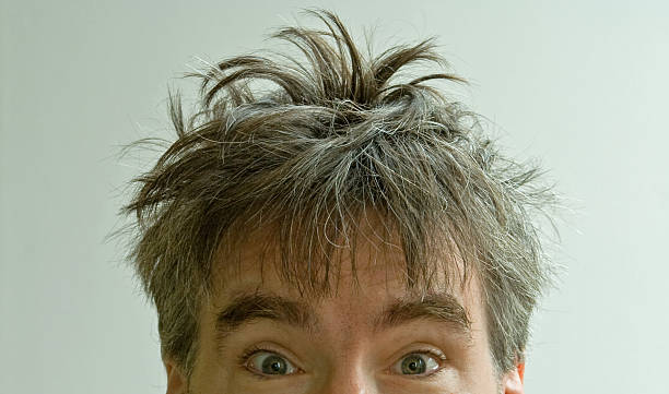 wide eyed male with crazy bed head on white background - messy hair stock photos and pictures