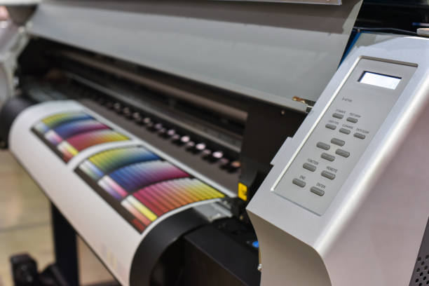 Wide format printer in work stock photo