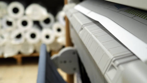 Wide format printer printing draft outline drawing Wide format printer is printing color design draft outline sketch drawing in the printing house. Design office supply equipment. blotter stock pictures, royalty-free photos & images