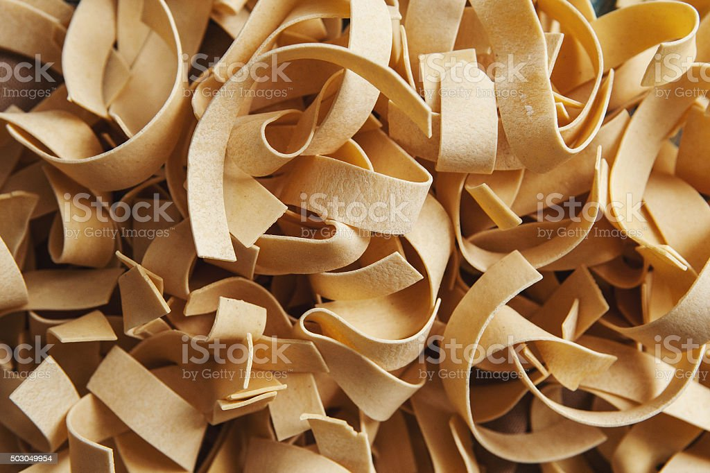 Wide italian pasta pappardelle background stock photo