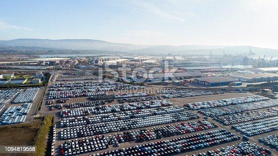 Wide landscape of car depot near sea harbor on coast
