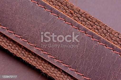 655272874 istock photo Wide leather belt belt stitched with threads close up 1223472117