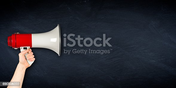 istock wide megaphone blackboard business background 690508222