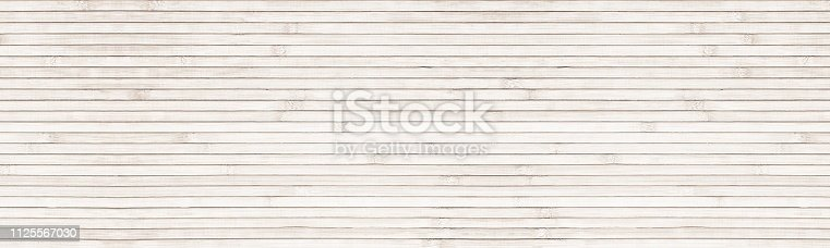 Wide natural bamboo background. Light wooden surface panoramic texture