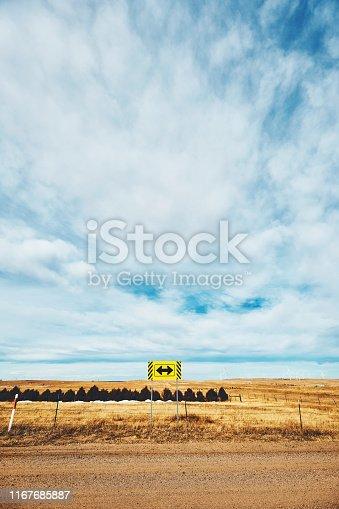 Wide open landscape under cloudy blue sky in Colorado, USA