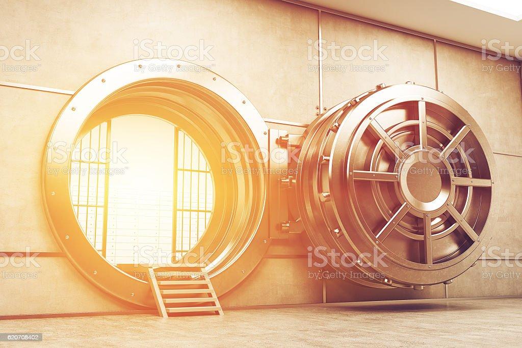 Wide open sunlit vault door stock photo