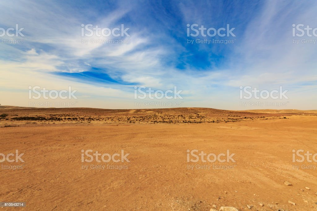 Wide panorama of Negev desert with clouds at wind stock photo