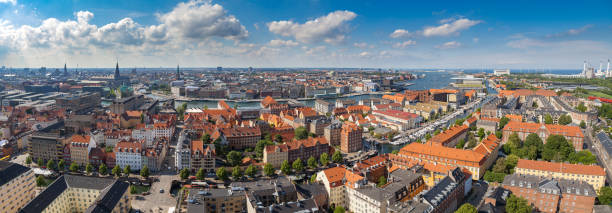 Wide panoramic aerial view of Copenhagen red roofs and canal. stock photo