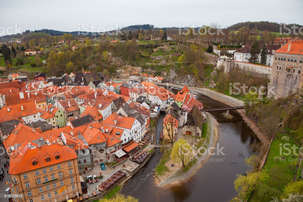 Wide panoramic view of Cesky Krumlov from the highest castle tower. Cloudy spring weather. UNESCO World Heritage Site stock photo