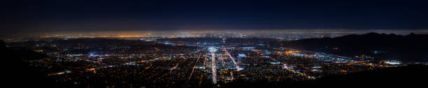 wide panoramic view of los angeles at night - san fernando valley stock photos and pictures