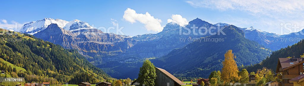Wide panoramic view of Swiss Alps near Lenk Im Simmental royalty-free stock photo