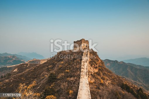 wide panoramic view on great wall with watch tower at sunset hour