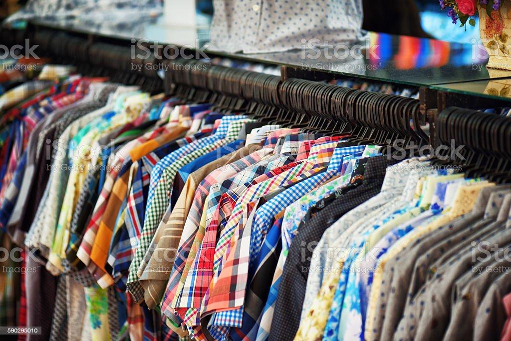 Wide range of men's shirts in store royaltyfri bildbanksbilder