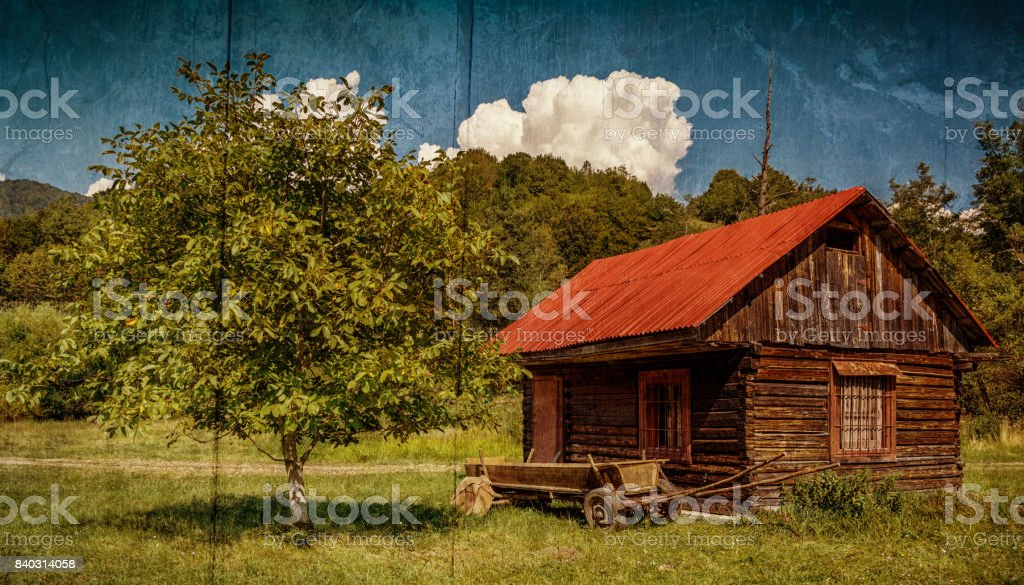 Wide retro shot of an abandoned log house stock photo
