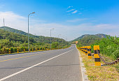 Outdoor,beautiful,park,background,tourism,city,tree,view,city,mountain,famous,architecture,europe,road,highway,sky,asphalt,landscape,travel,blue,way,cloud,rural ,cloud,summer,line,country,horizon,empty,nobody,green,street,grass,straight,transportation,long,wide,wallpaper,poster,background,mountain,double yellow line,street light,chain,cement,pitch , guardrail, high voltage line tower, logistics, no car,