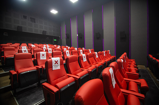 Wide shot, cinema hall with red color chair, no people