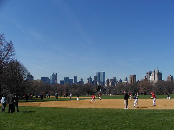 Wide shot of a baseball game in Central Park stock photo