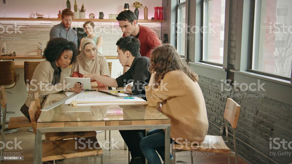 Wide Shot of a Muslim Businesswoman Leading a Multi-Ethnic Team Meeting stock photo