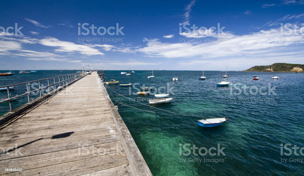 Wide shot of boats tied to the dock stock photo
