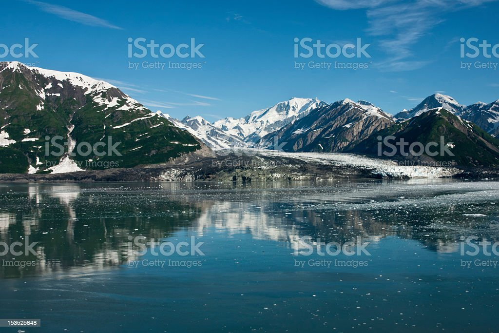 Wide shot on glacier reaching the sea in Alaska, USA. stock photo