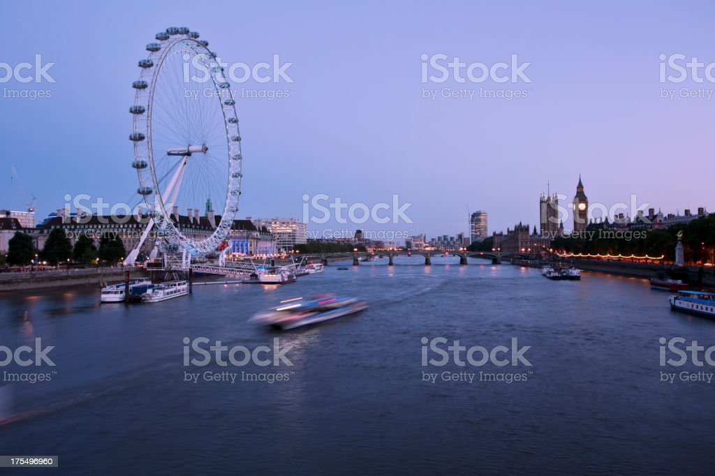 Wide side shot of London at dusk with the London eye royalty-free stock photo