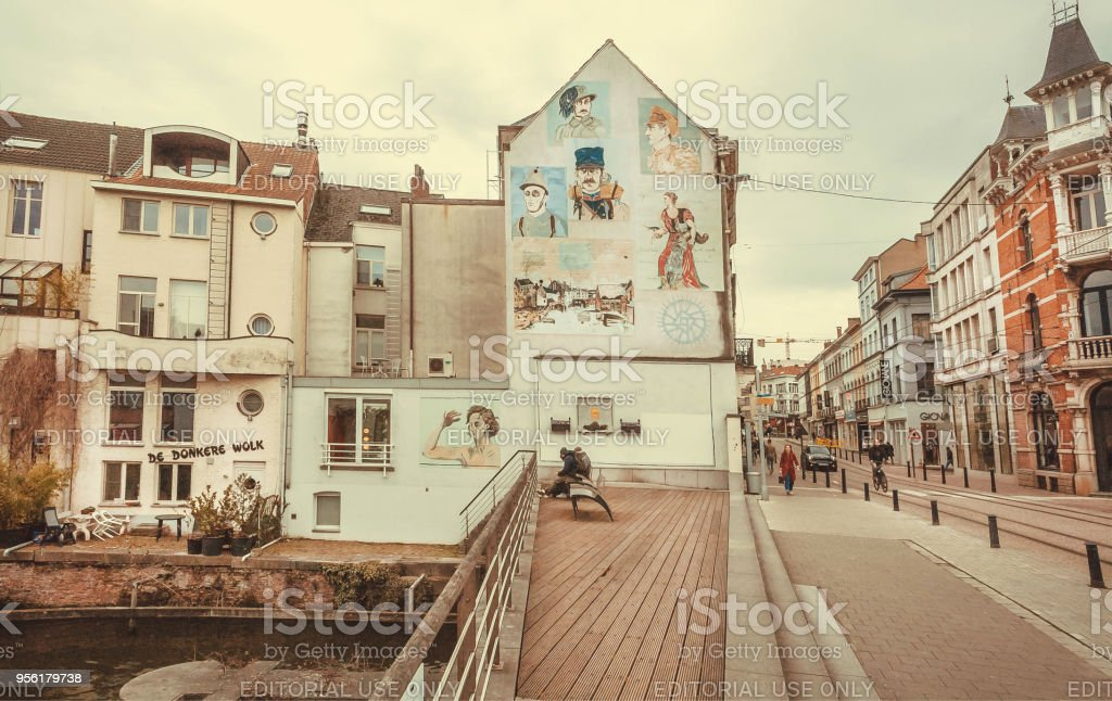Wide street with old houses, riverbanks and cobbled stones at rainy weather stock photo