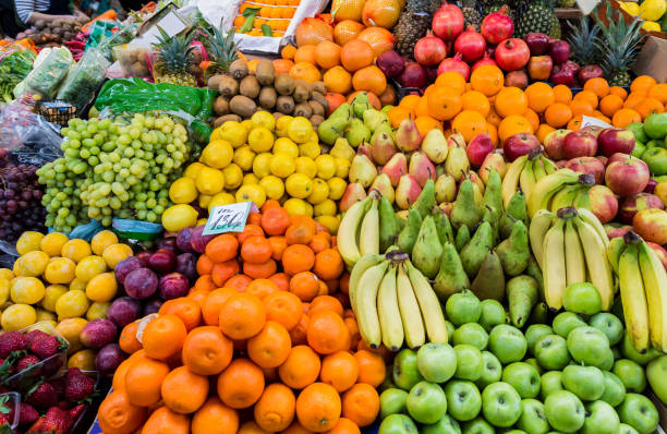 A wide variety of fruits in trays on the market