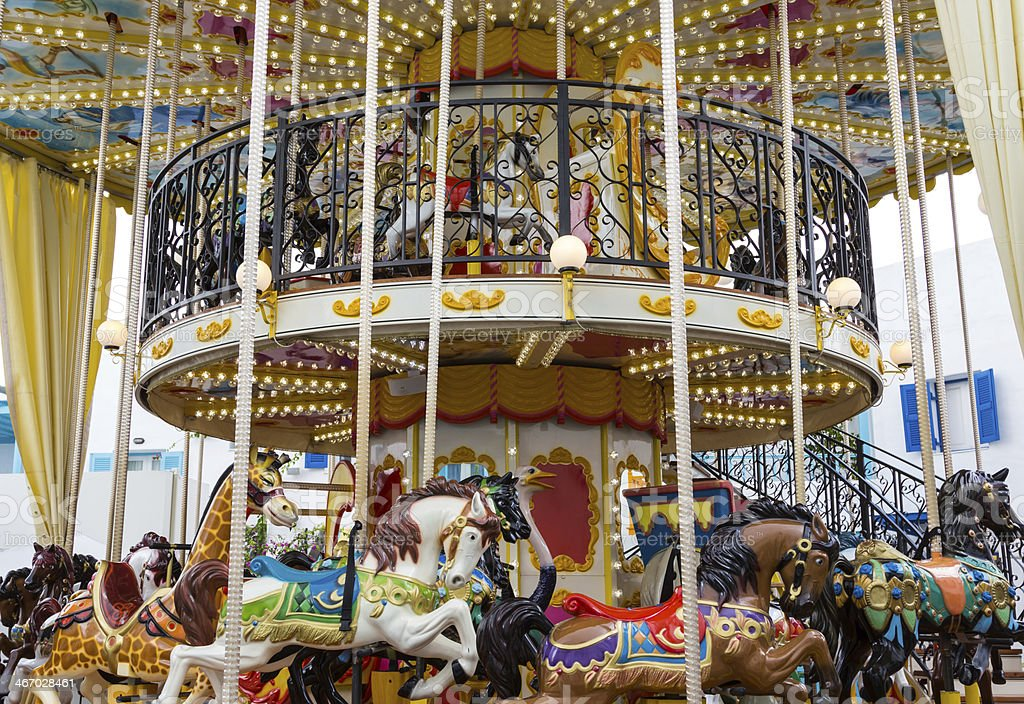 Wide view merry go round in carnival stock photo