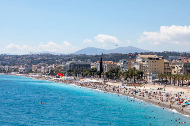 Wide view of Nice beaches busy at the start of summer break stock photo