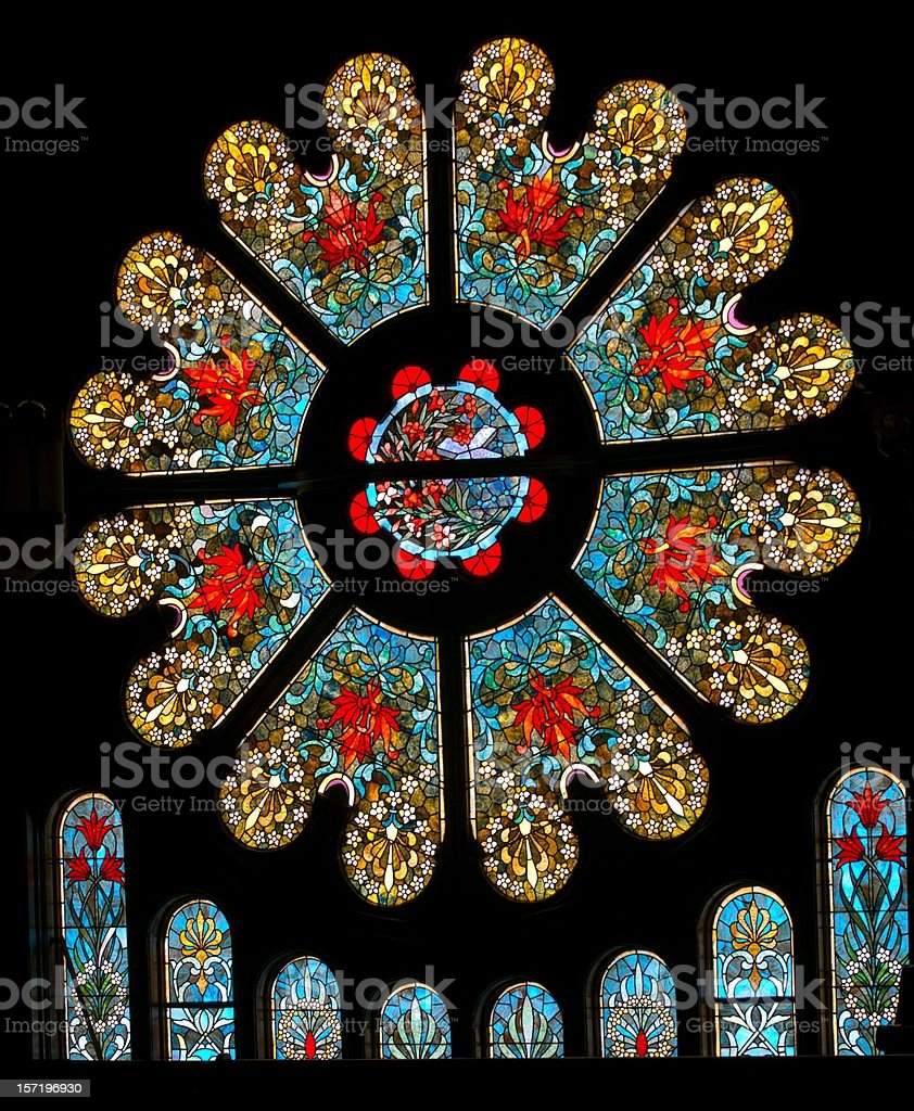 Wide view of ornate antique stained glass window royalty-free stock photo
