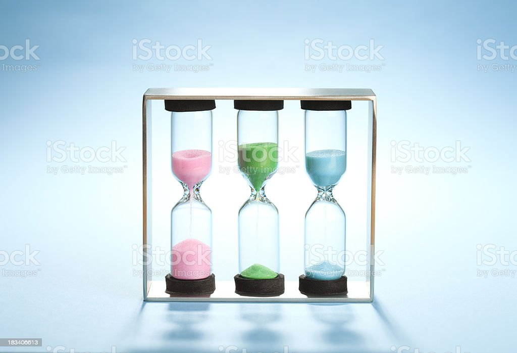Wide view, set of three sandtimers (hourglasses) stock photo