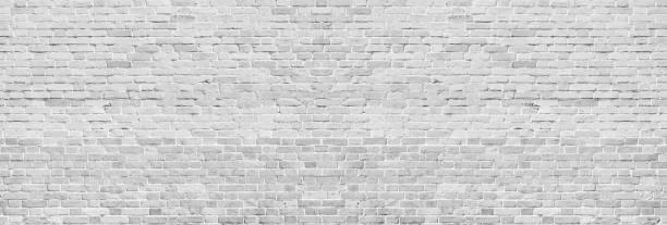 wide white washed brick wall texture. rough light gray vintage brickwork. whitewashed panoramic background - muro circundante imagens e fotografias de stock