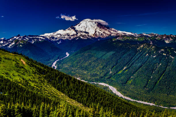 Wide-Angle Shot of Mount Rainier from Crystal Mountain. A Full Wide-Angle View of Snow-capped Mount Rainier from the Top of Crystal Mountain, Showing the White River Valley. mt rainier stock pictures, royalty-free photos & images