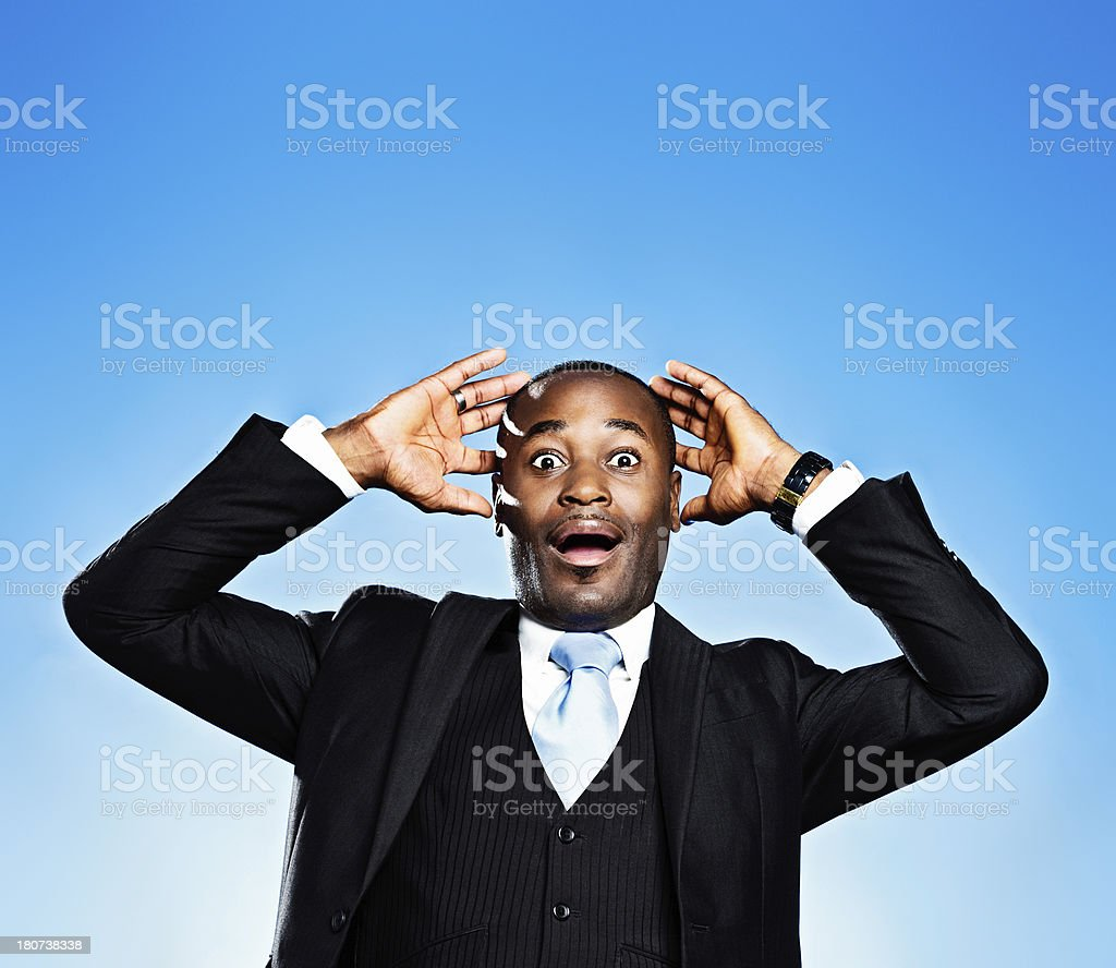 Wide-eyed, gaping, and amazed African-American businessman royalty-free stock photo