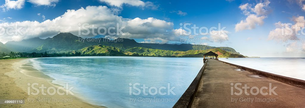 Widescreen panorama of Hanalei Bay and Pier on Kauai Hawaii stock photo
