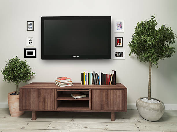 widescreen television with a wooden pedestal. 3d illustration - fernseher and der wand stock-fotos und bilder