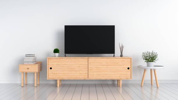 breitbild-tv in weißen wohnzimmer, 3d rendering - anrichte weiß stock-fotos und bilder