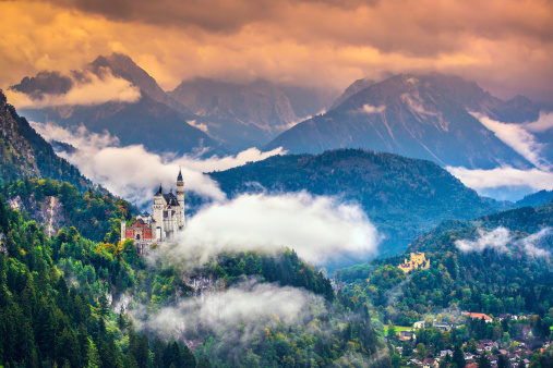 Wide-view of magnificent Neuschwanstein Castle in mountains