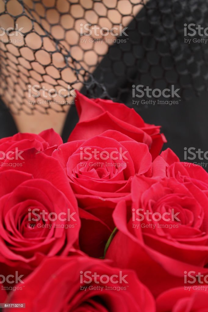 Widow Holds Flowers stock photo