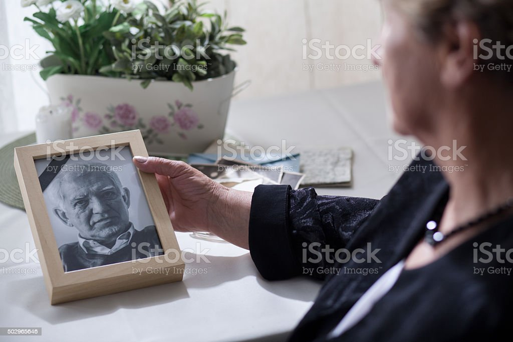 Widow looking at the photo stock photo