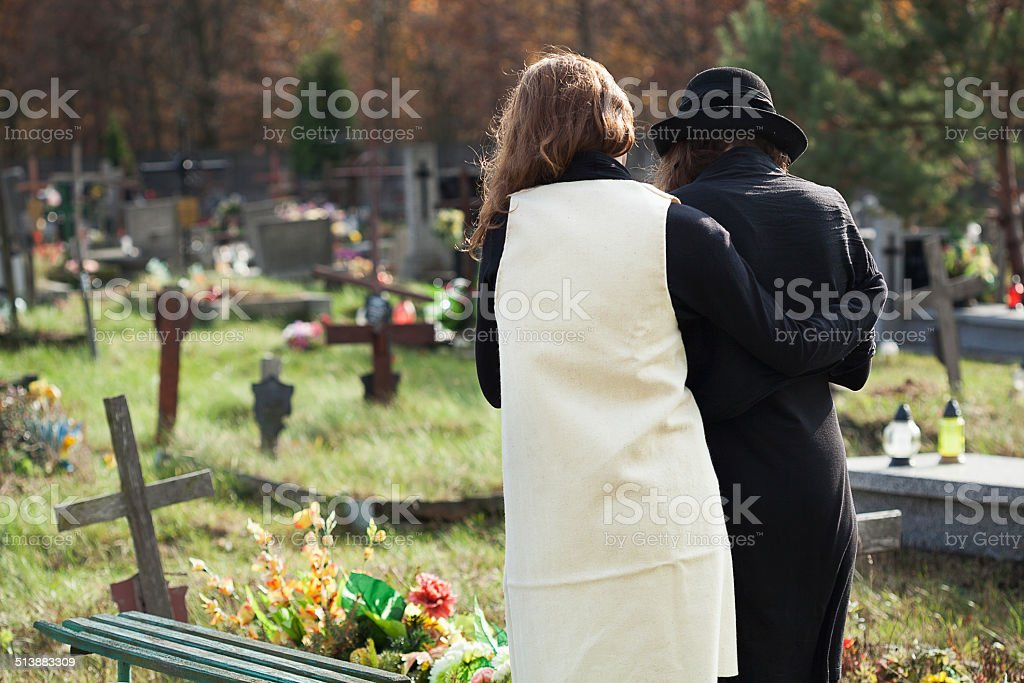 Widow supported by a friend stock photo