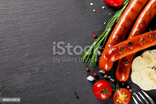 istock Wiener Sausages on black background. Top view. 856045828