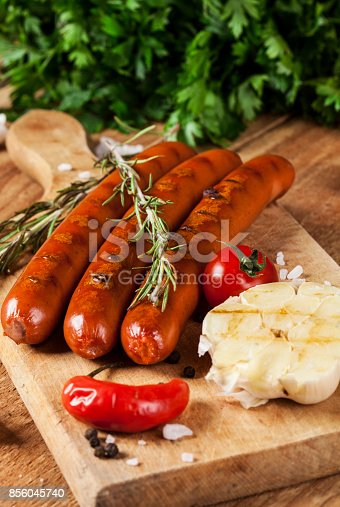 istock Wiener Sausages on wooden background 856045740