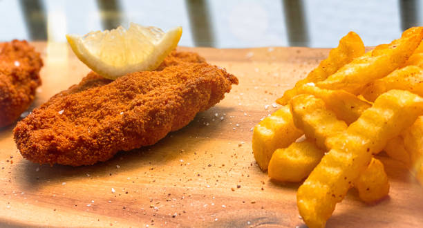Wiener Schnitzel and French fries stock photo