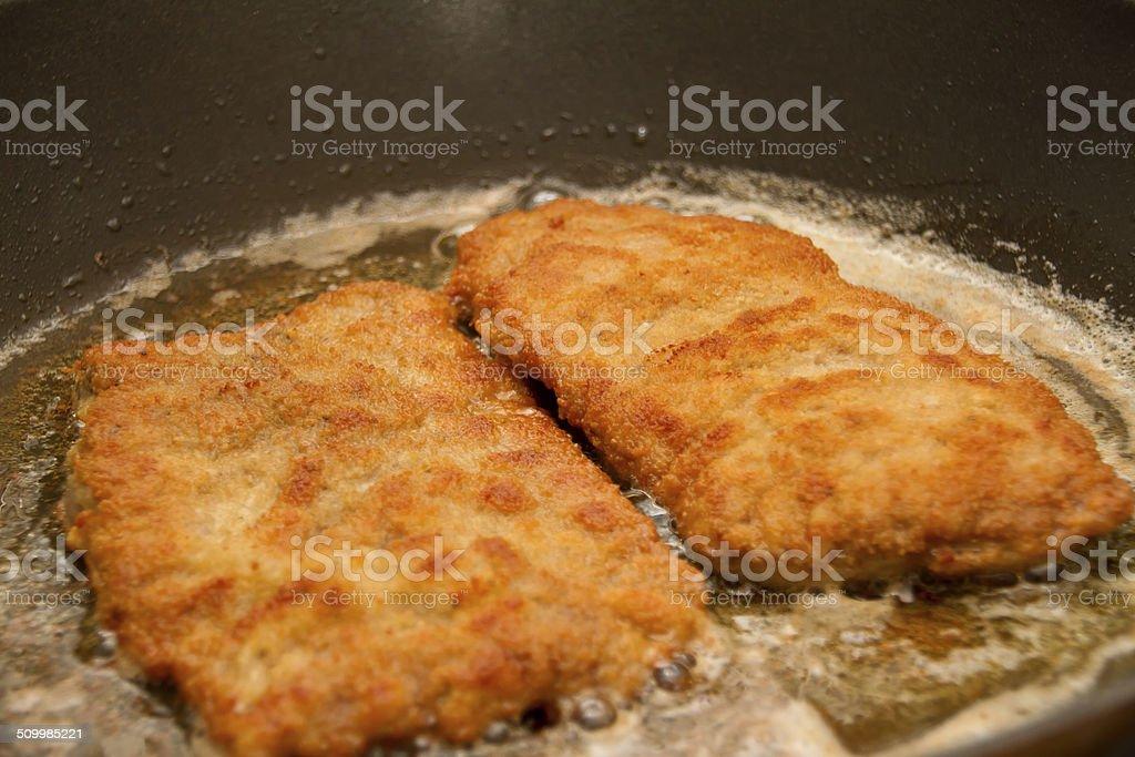 Wiener Schnitzel in pan stock photo