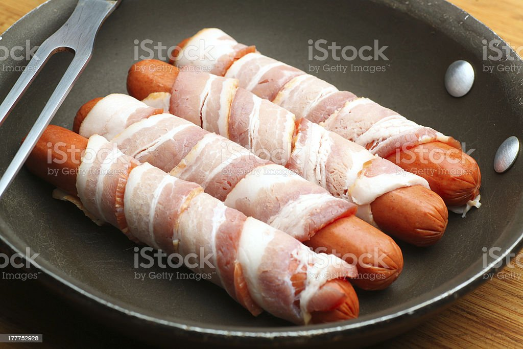 Wieners wrapped in bacon stock photo