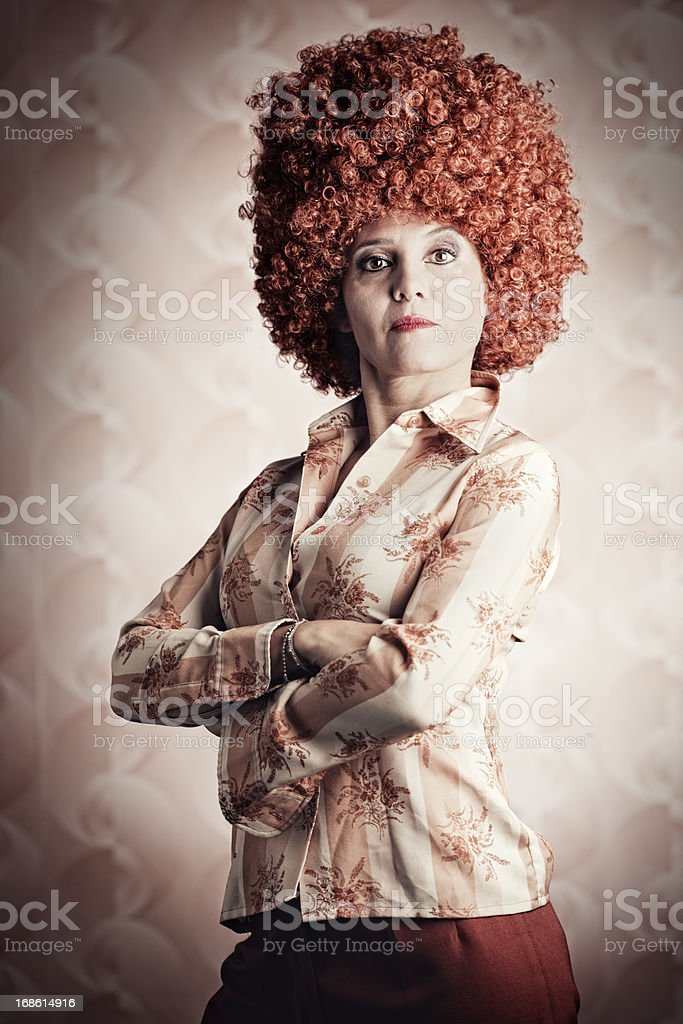 Wierd looking woman with huge red headed hair doo. stock photo
